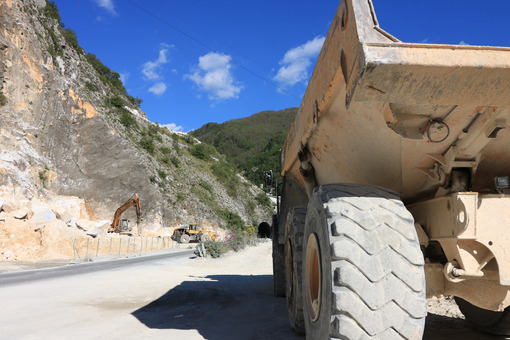 A dumper truck used in a Carrara marble quarry. Large yellow dum - MyVideoimage.com