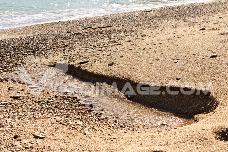 A fresh water spring flows from the beach. - MyVideoimage.com