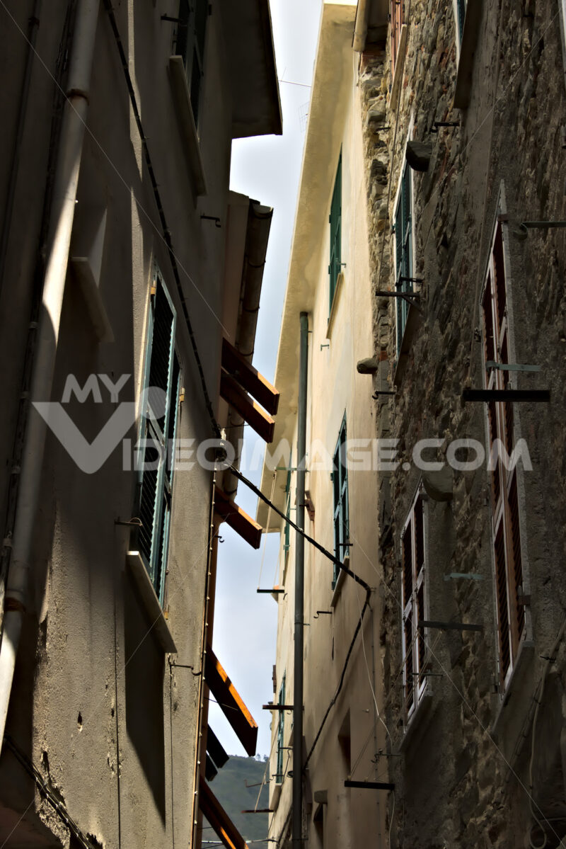 A typical Ligurian caruggio in the village of Corniglia in the Cinque Terre. - MyVideimage.com