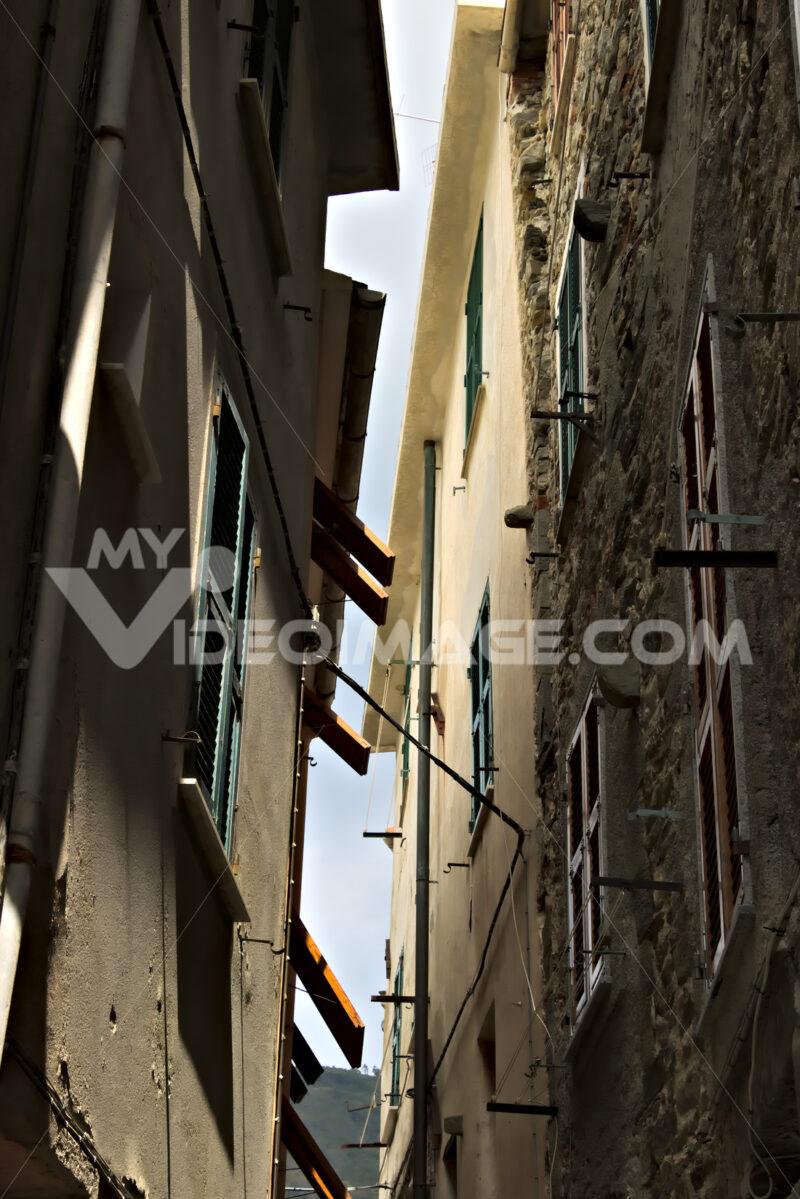 A typical Ligurian caruggio in the village of Corniglia in the Cinque Terre. - MyVideimage.com