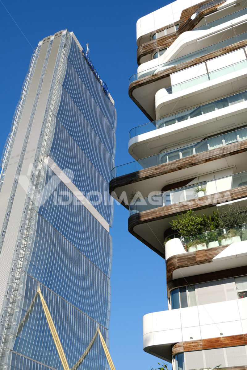 Allianz insurance skyscraper and buildings with residential houses designed by Zaha Hadid in Milan Citylife. - MyVideoimage.com