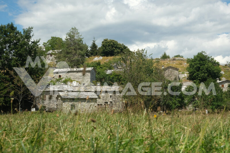 Alpine houses  in Campocatino, in the green valley of the Apuan Alps mountains. Alpine landscape with a small village. - MyVideoimage.com | Foto stock & Video footage