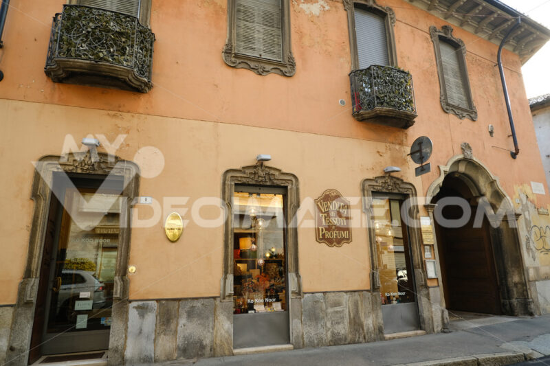 Ancient building with shops in the historic center of Busto Arsizio. Foto Busto Arsizio photo