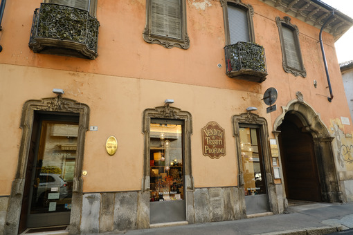 Ancient building with shops in the historic center of Busto Arsizio. Foto Busto Arsizio photo