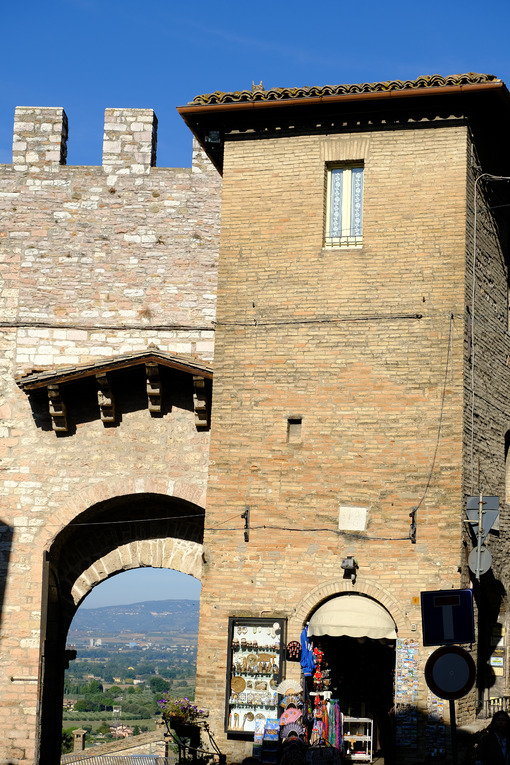 Ancient door San Pietro in Assisi. Made with mixed brick and stone masonry. - MyVideoimage.com