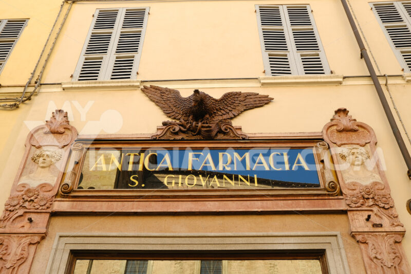 Ancient sign of a pharmacy shop dominated by a sculpture depicting an eagle. - MyVideoimage.com