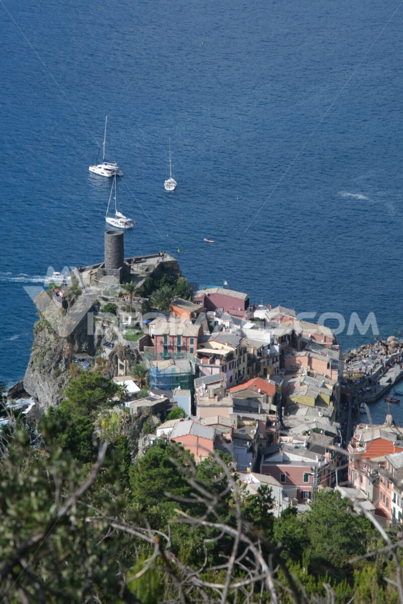 Ancient tower dominates the sea with boats. Vernazza, Cinque Terre, La Spezia, Italy. - MyVideimage.com
