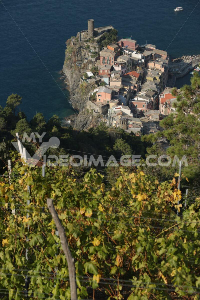 Ancient tower dominates the sea with boats. Vernazza, Cinque Terre, La Spezia, Italy. - MyVideimage.com