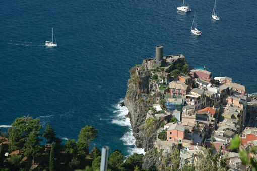 Ancient tower dominates the sea with boats. Vernazza, Cinque Terre, La Spezia, Italy. - MyVideoimage.com