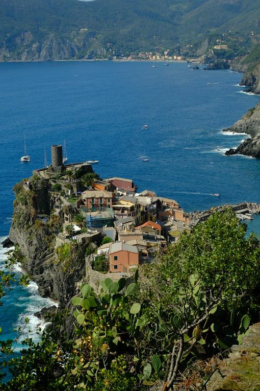 Ancient tower dominates the sea with boats. Vernazza, Cinque Terre, La Spezia, Italy. - MyVideoimage.com