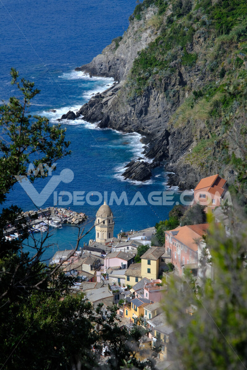 Ancient tower dominates the sea with boats. Vernazza, Cinque Terre, La Spezia, Italy. - LEphotoart.com
