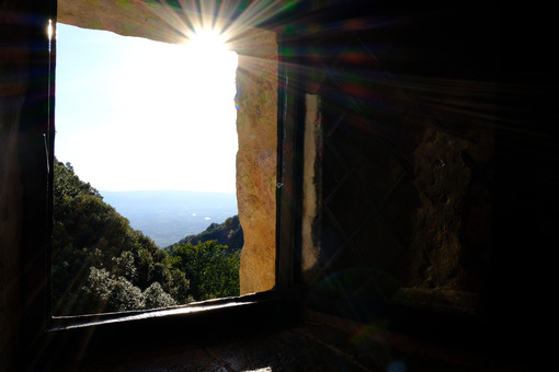 Ancient window with a sunbeam in a building built in flat in the Umbrian countryside (Italy) - MyVideoimage.com