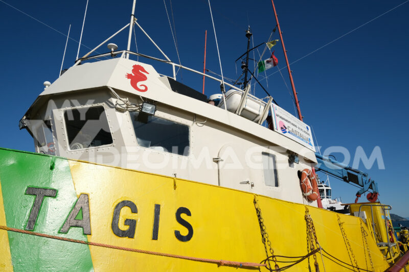 Anti-pollution vessel TAGIS of Castalia anchored at the port of La Spezia. Painted hull of various colors: Yellow, green, red. - MyVideoimage.com