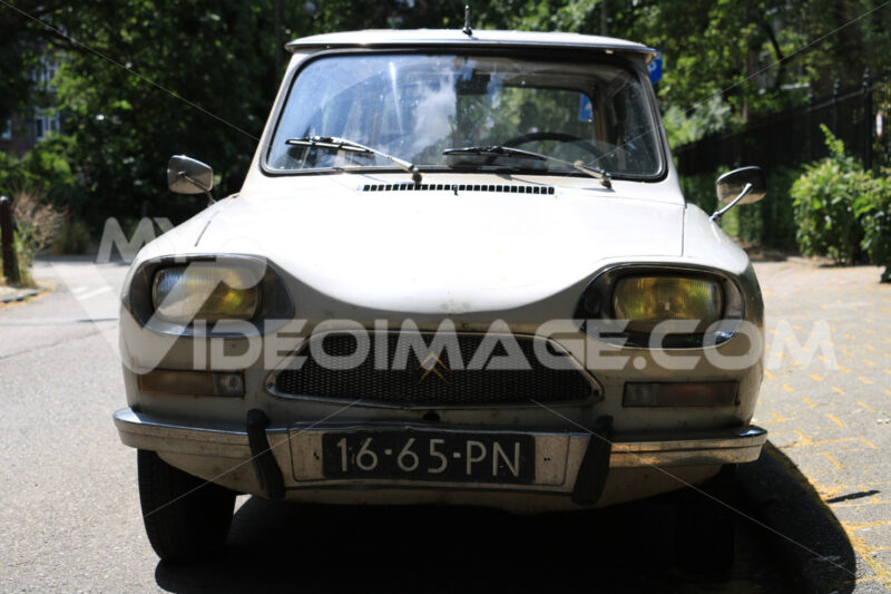 Antique Citroen Ami 8 car in beige parked on the road. Foto automobili. Cars photos.