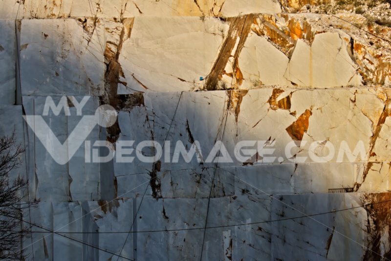 Apuan Alps, Carrara, Tuscany, Italy. March 28, 2019. A quarry of white marble. The precious white Carrara marble has been extracted from the Alpi Apuane quarries since Roman times. - MyVideoimage.com