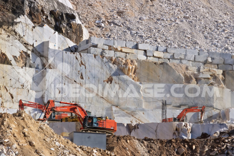 Apuan Alps, Carrara, Tuscany, Italy. March 28, 2019.  An excavator in a quarry of white Carrara marble. - LEphotoart.com