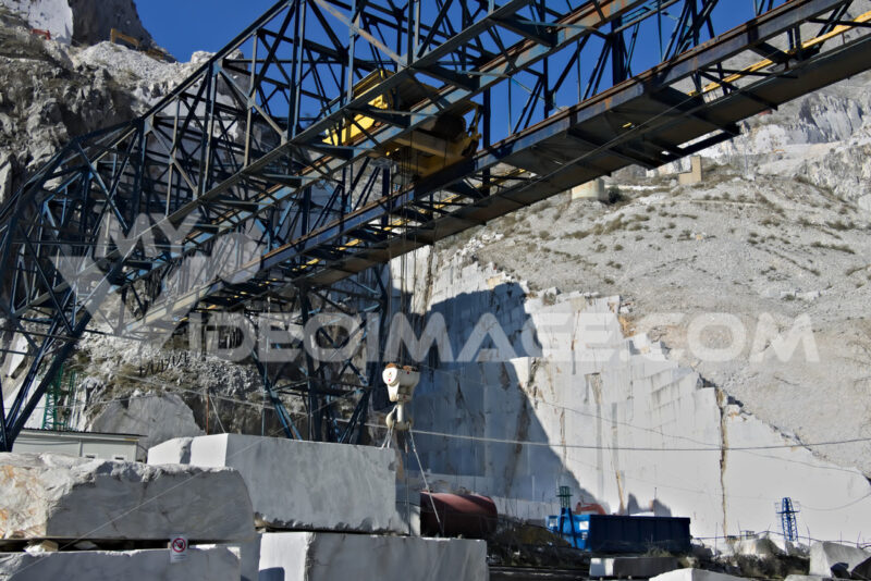 Apuan Alps, Carrara, Tuscany, Italy. March 28, 2019. An overhead crane in a white marble quarry - MyVideoimage.com