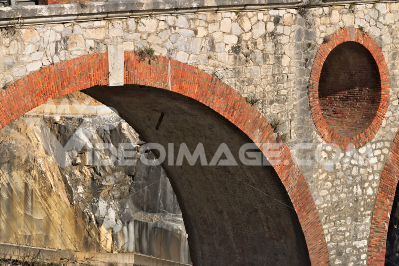Apuan Alps, Carrara, Tuscany, Italy. March 28, 2019. Ancient bridge in the marble quarries. - MyVideoimage.com
