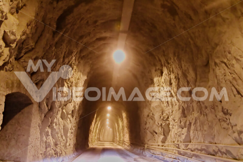 Apuan Alps, Carrara, Tuscany, Italy. March 28, 2019. Tunnel in the Carrara mountains. - MyVideoimage.com