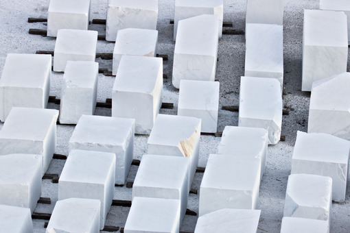 Apuan Alps, Carrara, Tuscany, Italy. March 28, 2019. White Carrara marble blocks in a warehouse - MyVideoimage.com