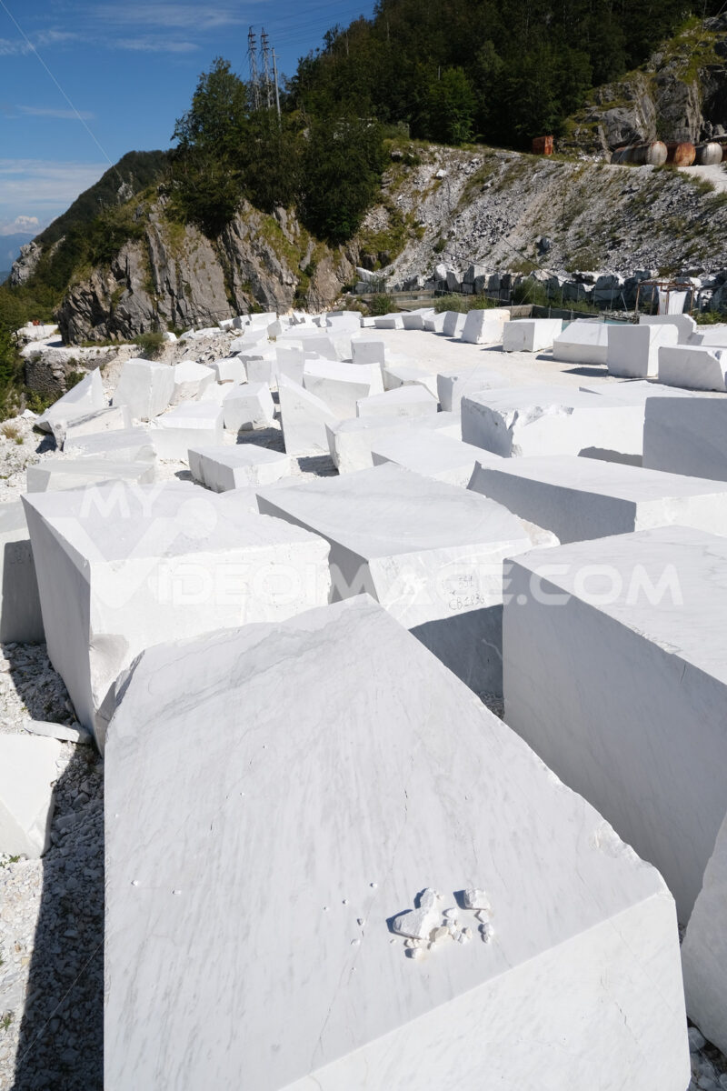 Apuan marble. Blocks of white Carrara marble deposited in a square near the quarries. Stock photos. - MyVideoimage.com | Foto stock & Video footage