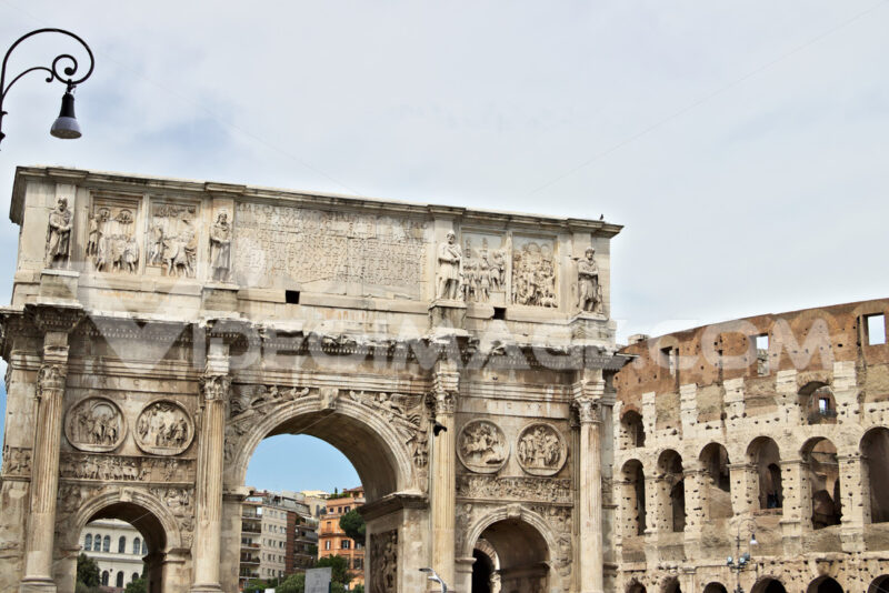 Arch of Constantine. The arch is located near the Colosseum and is designed to commemorate the victory of Constantine against Maxentius. - LEphotoart.com