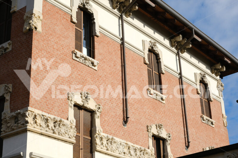 Art Nouveau building in the city of Busto Arsizio. Brick facade and floral decorations. - MyVideoimage.com