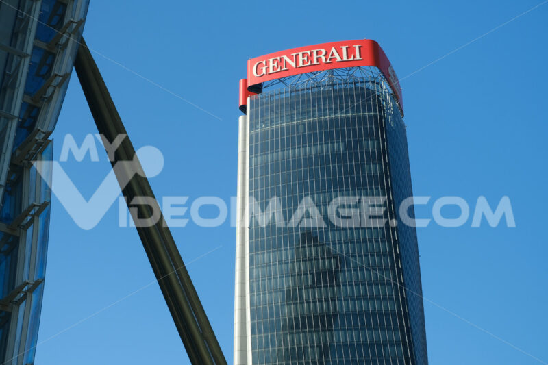 Assicurazioni Generali tower  Assicurazioni Generali tower with sign logo. Three towers. Milan. CityLife includes three skyscrapers and pedestrian areas with greenery. - MyVideoimage.com