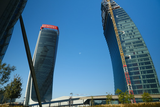 Assicurazioni Generali tower and Libeskind tower of PwC. Three towers. Milan. CityLife includes three skyscrapers and pedestrian areas with greenery. - MyVideoimage.com