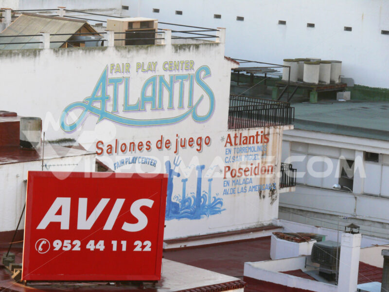 Avis Car rental. Advertising signs on building facades. - MyVideoimage.com | Foto stock & Video footage