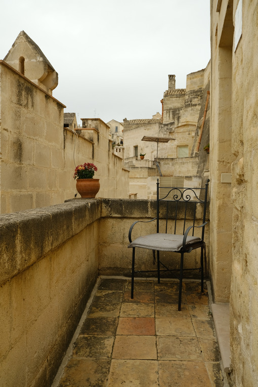 Balcony with iron chairs in a house in the city of Matera. - MyVideoimage.com