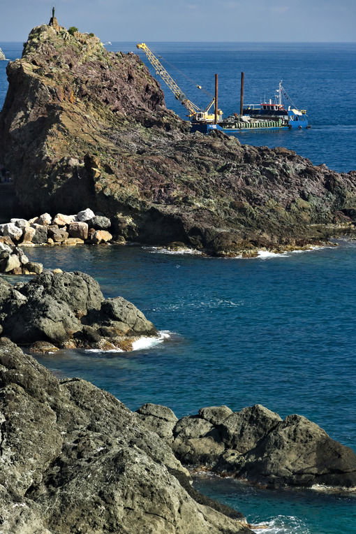 Barge on the Ligurian Sea carries materials. - MyVideimage.com