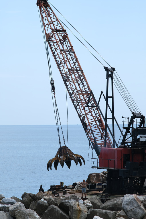 Barge with crane for dredging the seabed at the port of Riomaggiore, Cinque Terre, royalty free - LEphotoart.com