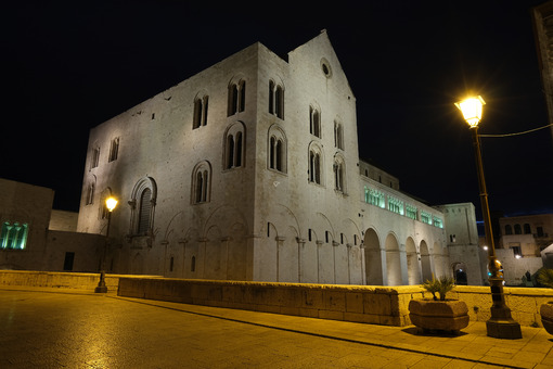 Basilica of San Nicola in Bari and Via Venezia on the wall. Shooting with night light and street lamps. Foto Bari photo.