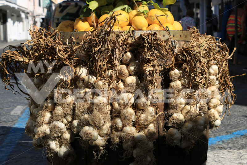 Basket with garlic and lemons for sale in the Island of Ischia, - MyVideoimage.com