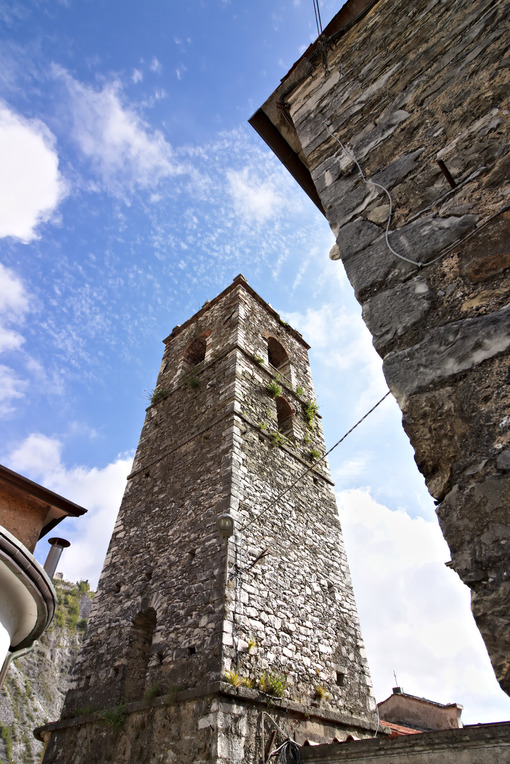 Bell tower of the church built with white marble pebbles. The ancient village, famous for its lard, is located in the heart of the Carrara marble quarries. Colonnata, Carrara, Tuscany, Italy. - LEphotoart.com