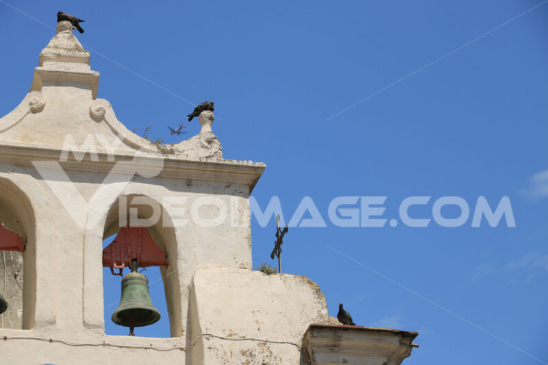 Bell tower. Procida photos. Bell tower with bells in a Mediterranean church on the island of - MyVideoimage.com | Foto stock & Video footage