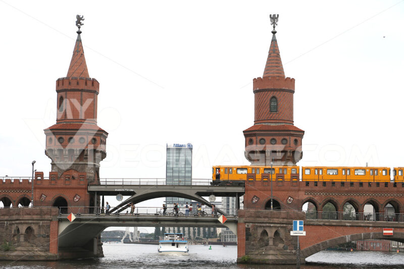 "Berlin, Germany, 13 June 2018. The two-level ""Oberbaumbrücke"" bridge over the Spree river. The towers  are built in red brick - MyVideoimage.com"