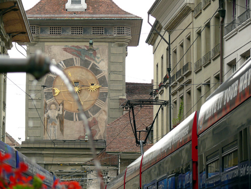 Bern street with clock and fountain. - MyVideoimage.com