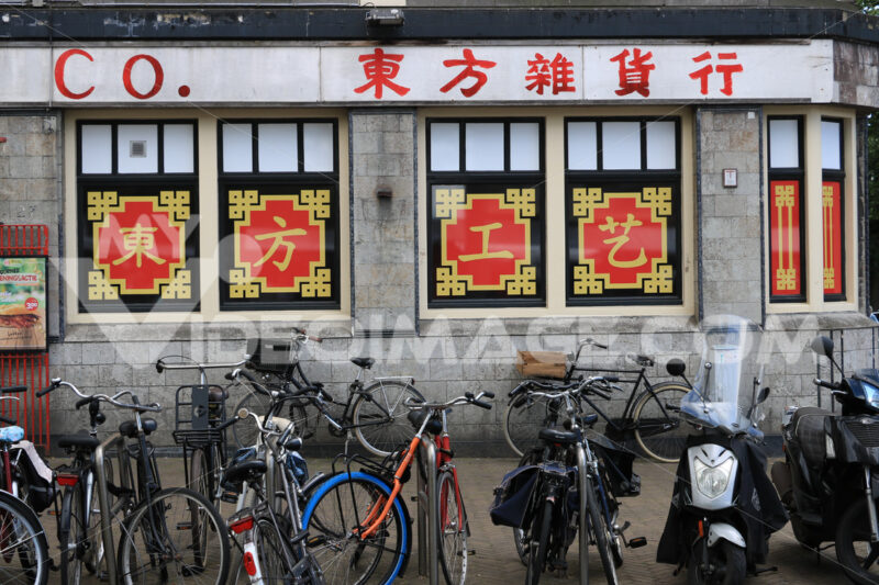 Bicycle parking in front of a shop with Chinese writing. - MyVideoimage.com