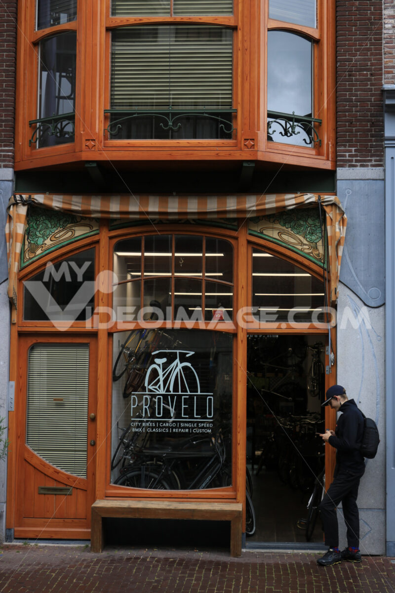 Bicycle shop with bay window and bow window in wood and glass. A - MyVideoimage.com