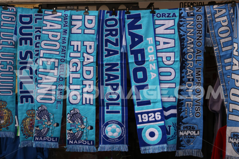 Blue scarves with the writing Napoli. - MyVideoimage.com