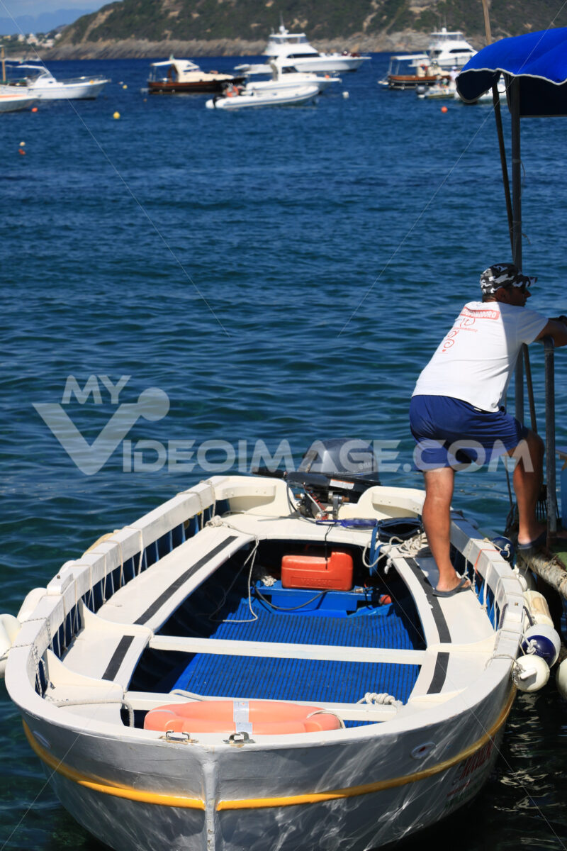 Boat anchored at the sea port. A small fishing boat. - MyVideoimage.com