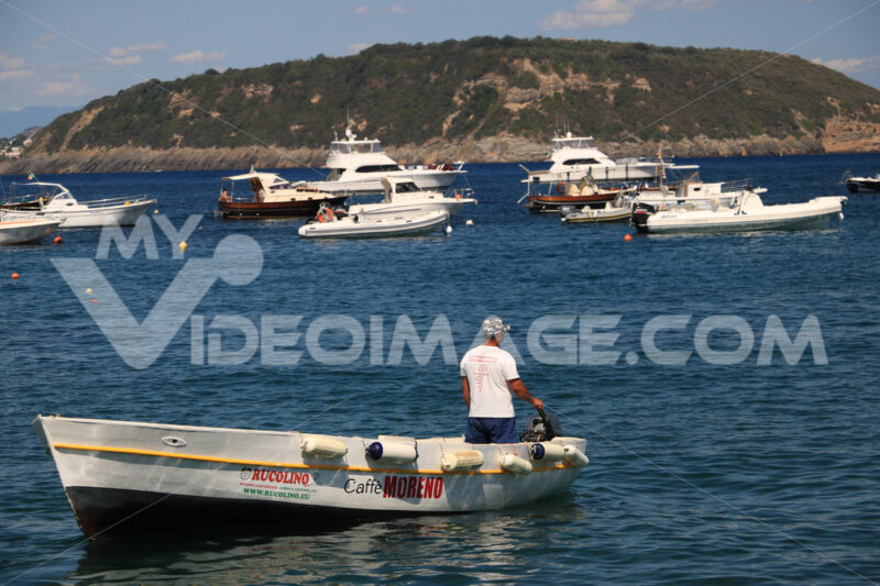 Boats anchored in front of the island of Ischia. - MyVideoimage.com