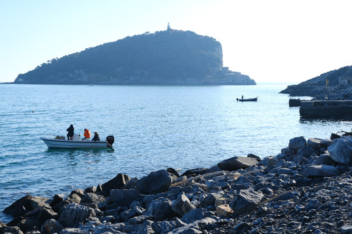 Boats in the sea between the island of Palmaria and Tino, near Portovenere and the Cinque Terre. - MyVideoimage.com