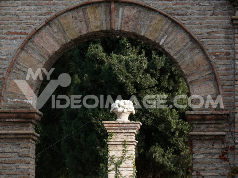 Brick arch and white marble sculpture - MyVideoimage.com