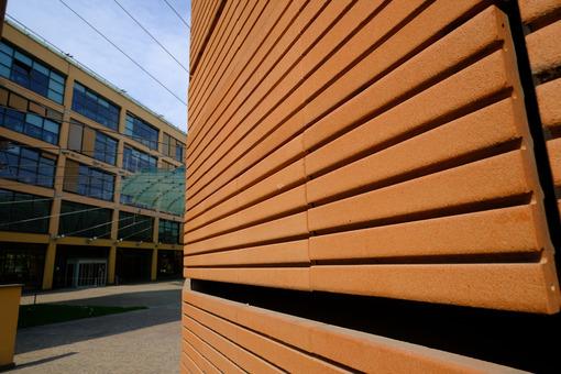 Brick building. Modern building with terracotta brick facade. Stock photos. - MyVideoimage.com | Foto stock & Video footage