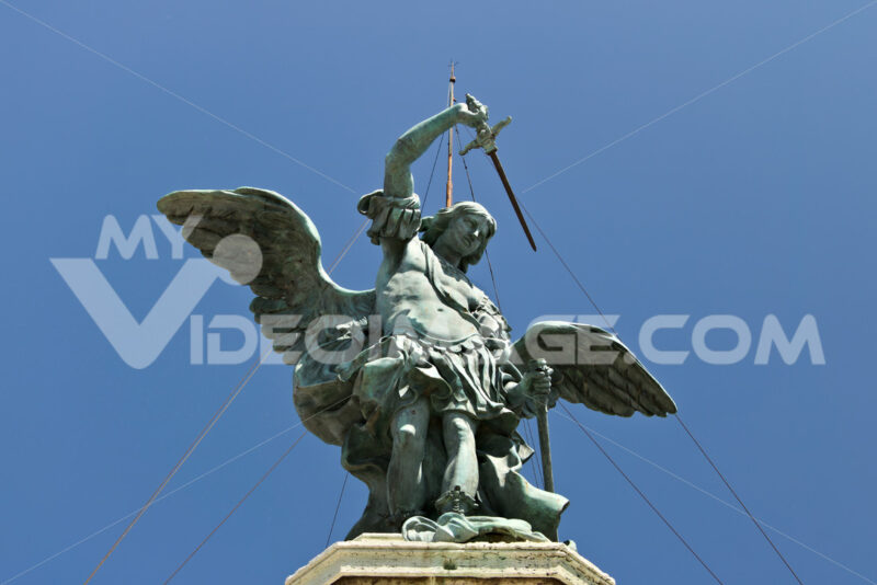 Bronze angel above Castel Sant'Angelo. Stock photo royalty free. Roma foto. Città italiane. Italian cities.