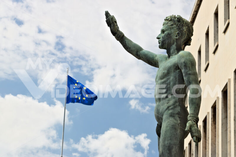 Bronze statue of the Sports Genius in the EUR, Rome and European flag. - MyVideoimage.com