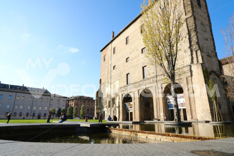 Buildings of the Pilotta in Parma. Fountain with pond and poplar trees. - MyVideoimage.com